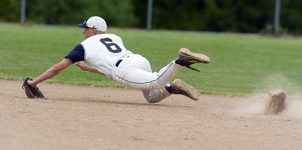 LEISA THOMPSON, The Ann Arbor News Saline's Andy Frey makes a leap to stop the ball and then fired it to first for the out during the Division 1 championship game against Battle Creek Lakeview Saturday at Holt High School.